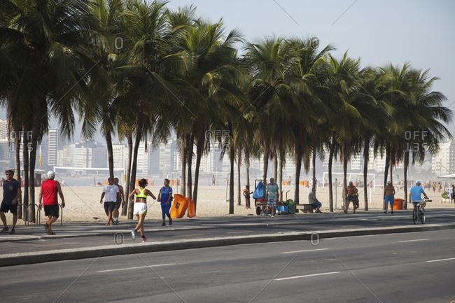 April 6, 2018: Jogging Along Avenue Atlantica On Copacabana Beach; Rio De Janeiro, Brazil