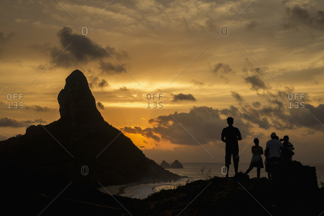 April 6, 2018: Brazil, Pernambuco, People admiring sunset over Morro do Pico from Forte dos Remedios; Fernando de Noronha