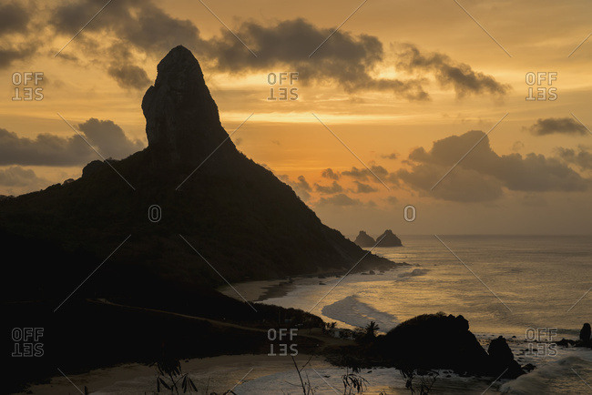April 6, 2018: Brazil, Pernambuco, View of Morro do Pico at sunset from Forte dos Remedios; Fernando de Noronha