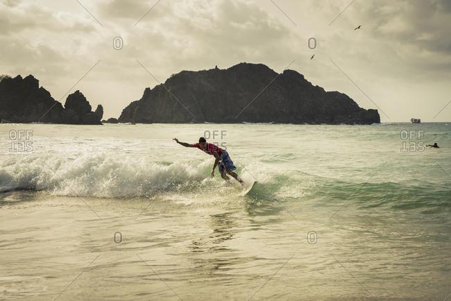 April 6, 2018: Surfing In Praia Da Cachorro, Unesco World Heritage Site; Fernando De Noronha, Pernambuco, Brazil