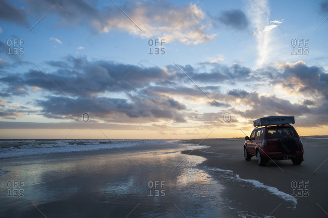 April 6, 2018: A Vehicle Sits On Casino Beach At Sunset, The Longest Beach In The World; Rio Grande Do Sul, Brazil