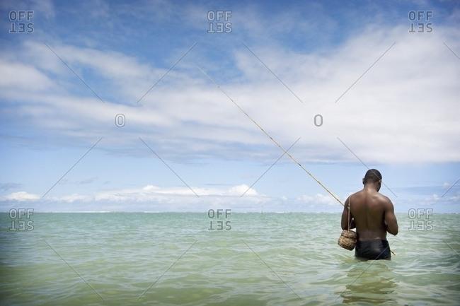 April 6, 2018: Fisherman Wading Into The Ocean, Brazil