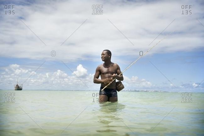 April 6, 2018: Man Fishing In Ocean, Brazil