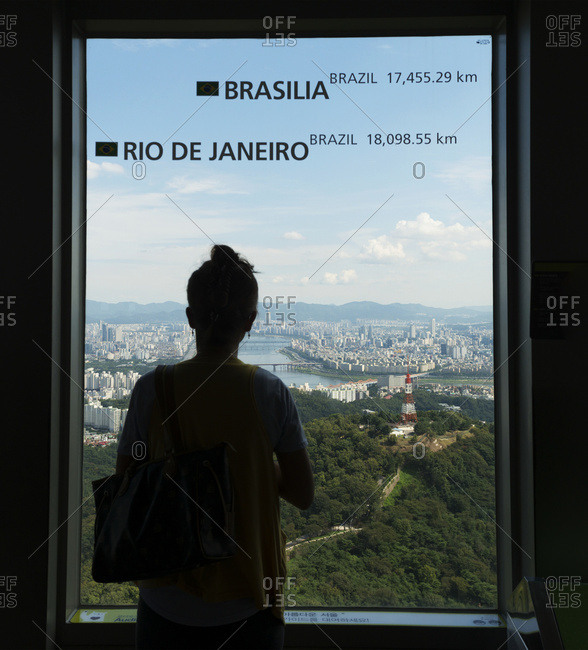 April 6, 2018: A Woman Stands At The Window Of Seoul Tower With A View Of The City Of Seoul; Seoul, South Korea