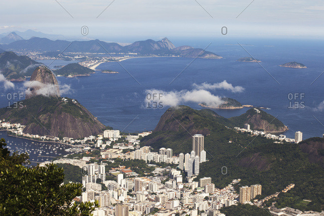 View Of Rio And Sugarloaf Mountain From Christ The Redeemer Statue, Corcovado Mountain, Tijaca National Park; Rio De Janeiro, Brazil