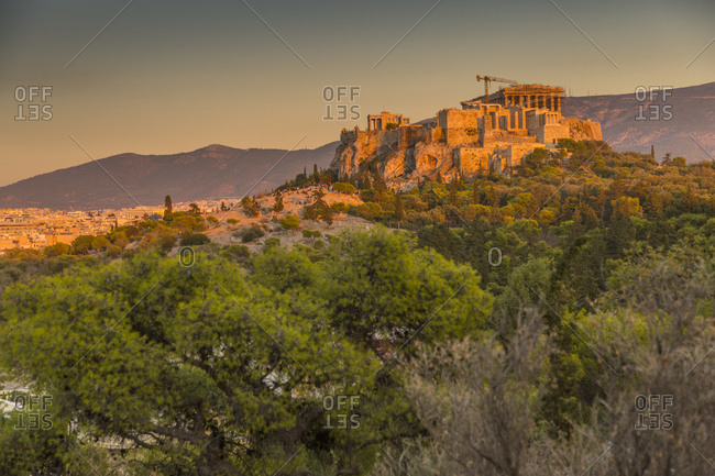 View of The Acropolis, UNESCO World Heritage Site, at sunset from Filopappou Hill, Athens, Greece, Europe