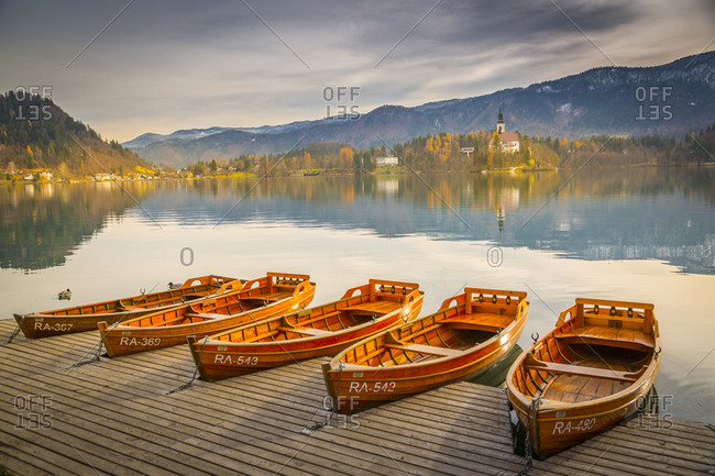 November 28, 2017: View of rowing boats on Lake Bled and Santa Maria Church (Church of Assumption), Gorenjska, Slovenia, Europe