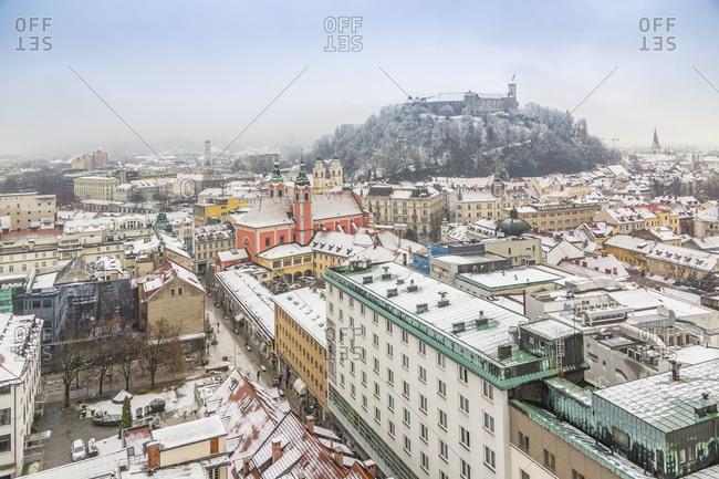 November 30, 2017: View of snow covered Ljubljana old town and Castle from The Skyscraper, Ljubljana, Slovenia, Europe