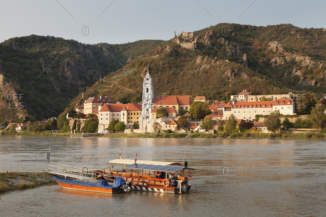 August 21, 2017: View over Danube River to Collegiate church and castle ruins, Durnstein, Wachau, Lower Austria, Austria, Europe