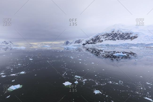 Atmospheric iceberg, mountain and glacier reflections, Neko Harbor, Andvord Bay, Graham Land, Antarctic Peninsula, Antarctica, Polar Regions