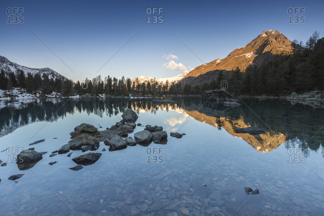 Corn Da Murasciola reflected in Lago di Saoseo, Val di Campo, Poschiavo region, Canton of Graubunden, Switzerland, Europe