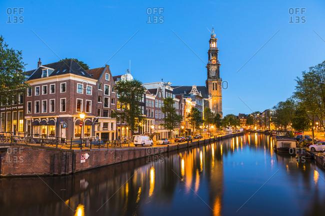 June 26, 2017: Prinsengracht Canal and Westerkerk, Amsterdam, Netherlands, Europe