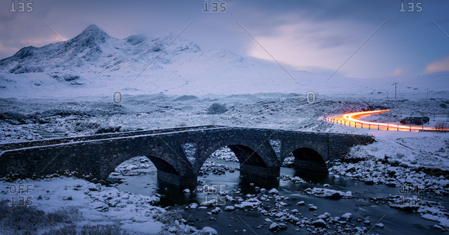 December 27, 2017: Sligachan Bridge in the snow with car light trails, Isle of Skye, Inner Hebrides, Scotland, United Kingdom, Europe
