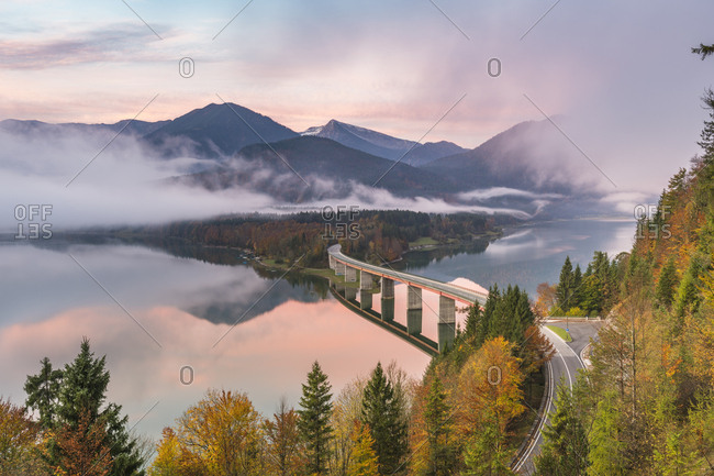 October 13, 2017: Sylvenstein Lake and bridge surrounded by the morning mist at dawn, Bad Tolz-Wolfratshausen district, Bavaria, Germany, Europe