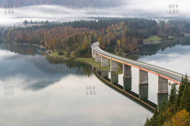 October 13, 2017: Sylvenstein Lake and bridge surrounded by the morning mist, Bad Tolz-Wolfratshausen district, Bavaria, Germany, Europe