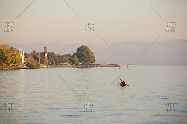 Canoeing on Lake Constance at sunset, Meersburg, Baden-Wurttemberg, Germany, Europe
