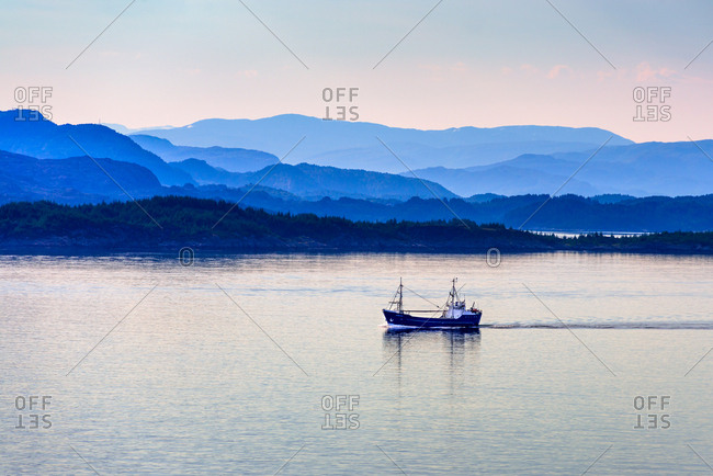 July 22, 2014: Tranquil coastal scenery at dawn south of Bergen, Hordaland, Norway, Scandinavia, Europe