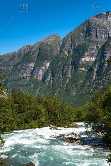 River through the mountains near Briksdals Glacier, Fjordane county, Norway, Scandinavia, Europe