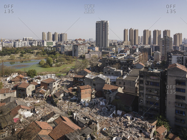 December 19, 2017: Tall buildings rise behind torn down old apartment buildings, Jingzhou, Hubei, China, Asia