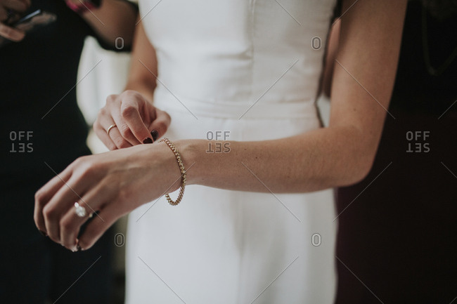 Columbus, Ohio  - January 28, 2017: Midsection of bride wearing wedding dress and bracelet