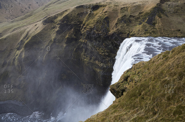 High angle scenic view of Skogafoss Waterfall on mountain