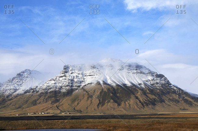 Idyllic view of mountains against cloudy sky during winter