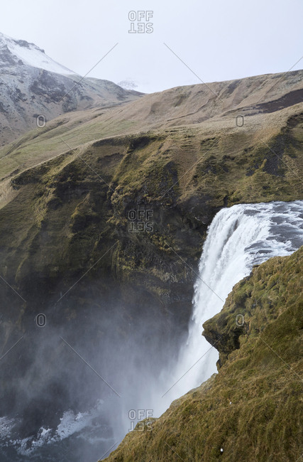 Scenic view of Skogafoss Waterfall on mountain