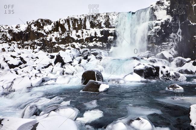 Idyllic view of waterfall during winter