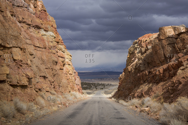 Road amidst rock formations against stormy clouds at Bryce Canyon National Park