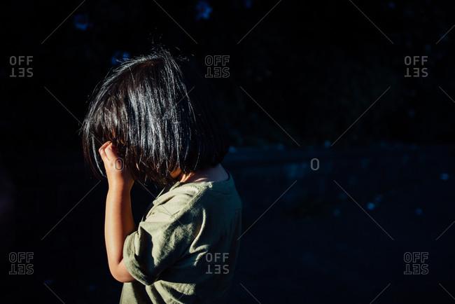 Toddler hiding face