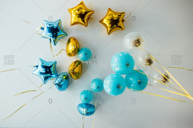 Yellow and blue helium balloons on the ceiling