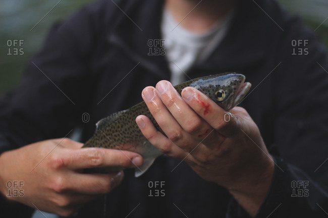 Fisherman holding freshly caught trout