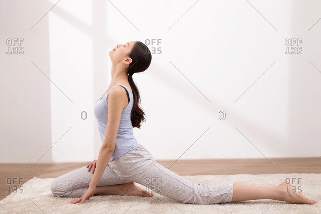 Young woman practices yoga