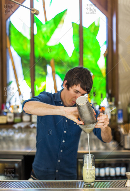 East Vancouver, Canada - July 03, 2017: Bartender pouring a beverage at a restaurant