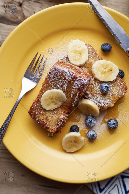 Overhead view of French toast with bananas and blueberries
