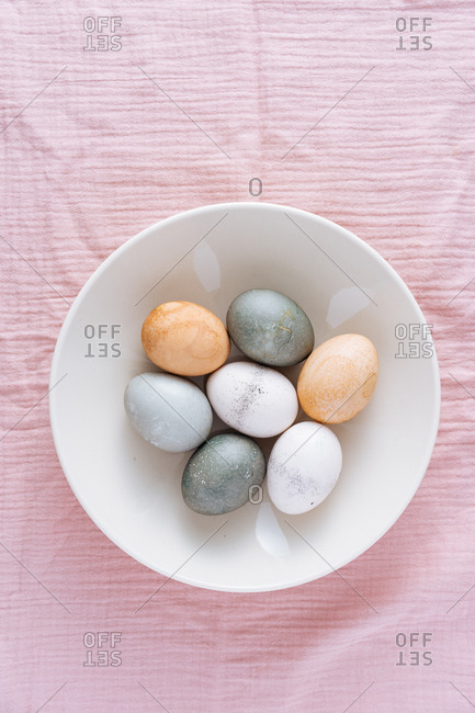 Top view of Easter eggs naturally dyed with vegetable and fruit