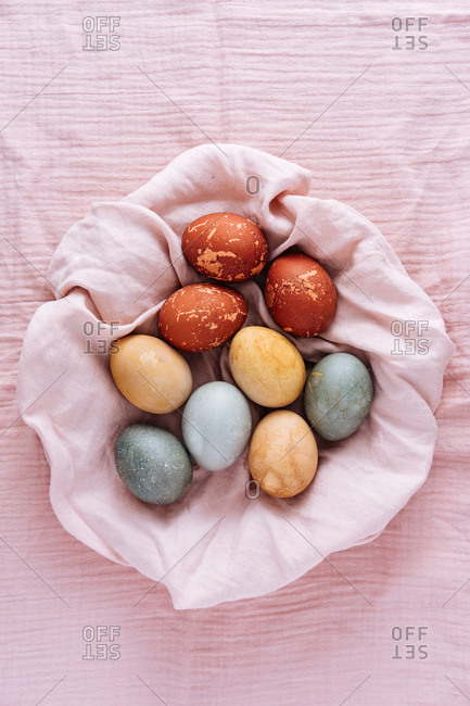 Naturally dyed Easter eggs on a pink cloth