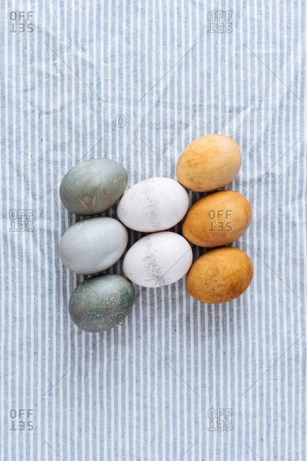 Naturally dyed Easter eggs on a blue striped cloth