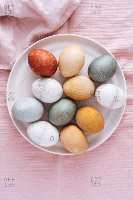 Top view of Easter eggs dyed with vegetable and fruit