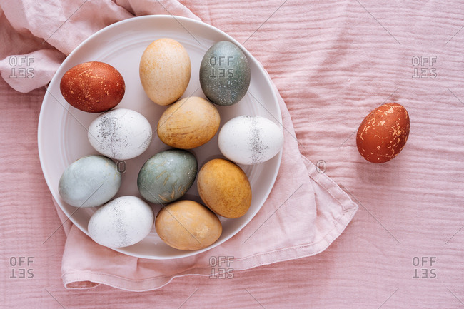 Overhead view of Easter eggs dyed with vegetable and fruit