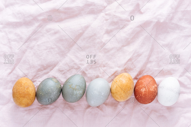 Easter eggs naturally dyed in a row