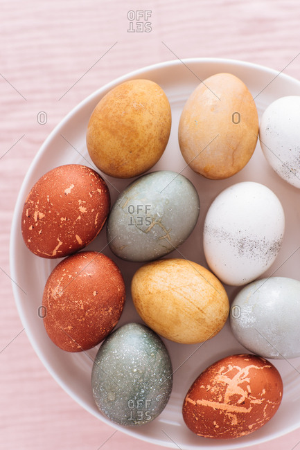 Top view of naturally dyed Easter eggs on a plate