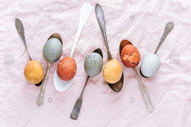 Easter eggs naturally dyed on spoons