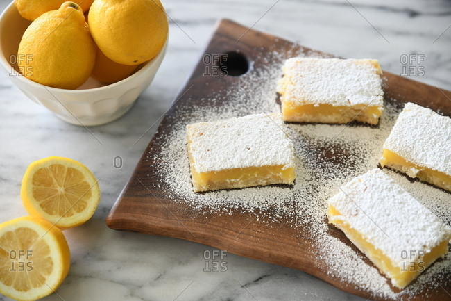 Lemon squares topped with powdered sugar