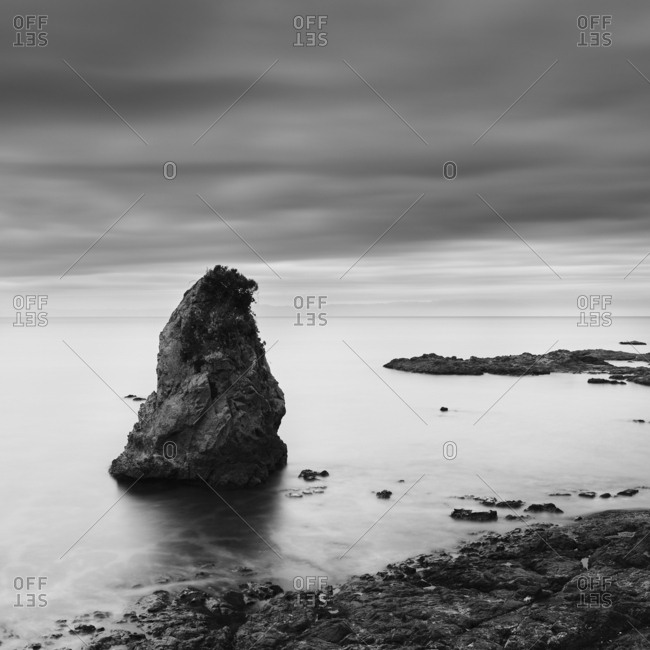 Long exposure black and white view of sea rocks at Tateishi Park, Kanagawa Prefecture, Japan