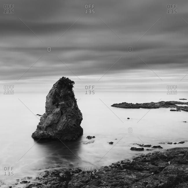Long exposure black and white view of sea rocks at Tateishi Park, Kanagawa Prefecture, Japan