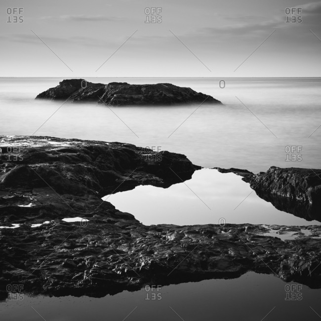 Black and white long exposure of sea rocks in the morning, Kanagawa Prefecture, Japan