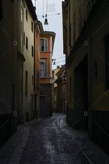 February 24, 2018: Narrow colorful alley on a sunny Winter day, Parma, Italy