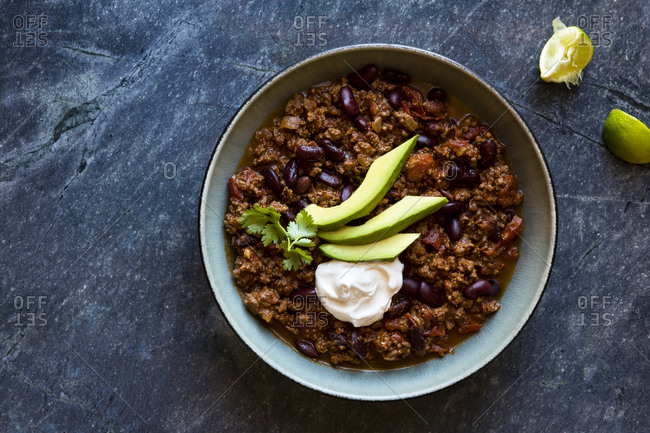 Beef and black bean chili with avocado and sour cream