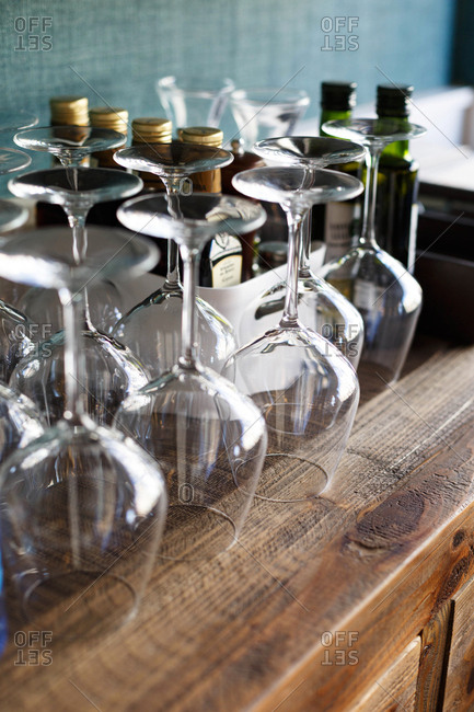 Empty wine glasses waiting to be used on wooden cabinet